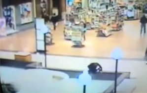 Girl Falls Into a Mall Fountain While Texting