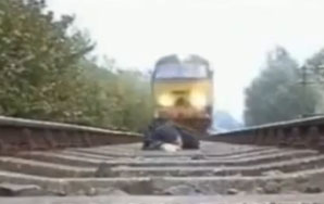 Crazy Person Videotapes Getting Run Over By A Train