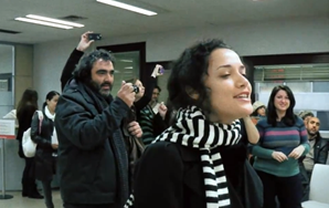 """Watch Flashmob Perform """"Here Comes The Sun"""" At Madrid Unemployment Office"""