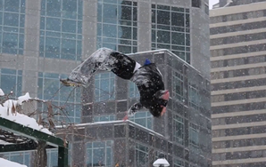 Ice Parkour: Man Runs Around Doing Cool Flips Over Walls