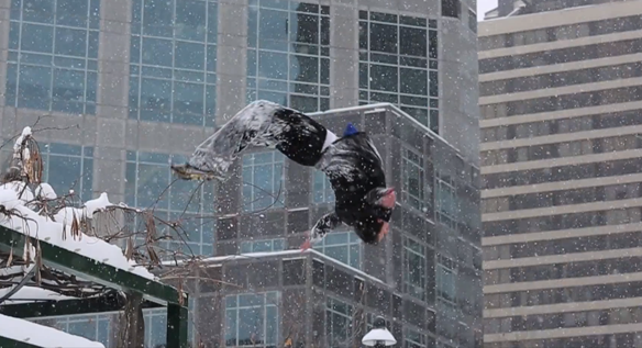 Ice Parkour: Man Runs Around Doing Cool Flips Over Walls In Wintertime