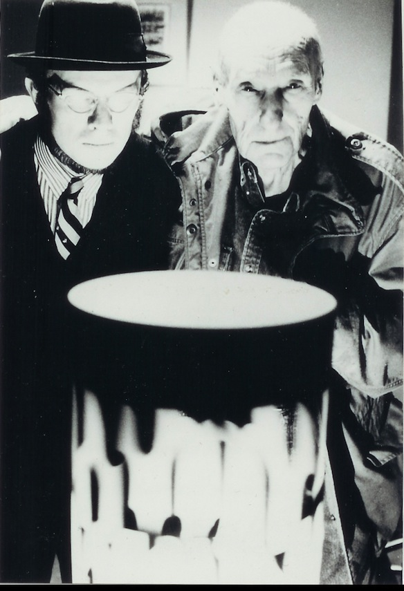 David Woodard and Burroughs standing in front of a dreamachine invented by Brion Gysin; Burroughs collaborated with Gysin in popularizing the literary cut-up technique, with which he wrote The Soft Machine, The Ticket That Exploded, and Nova Express.