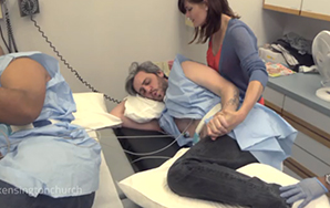 Watch These Two Men Experience Labor Contractions With Their Wives Coaching Them On