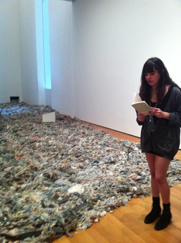 Mira reading at MoMA