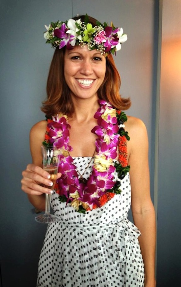 A photo of me the day that I graduated with my PhD. It's a Hawaiian tradition to pile leis on the graduate.