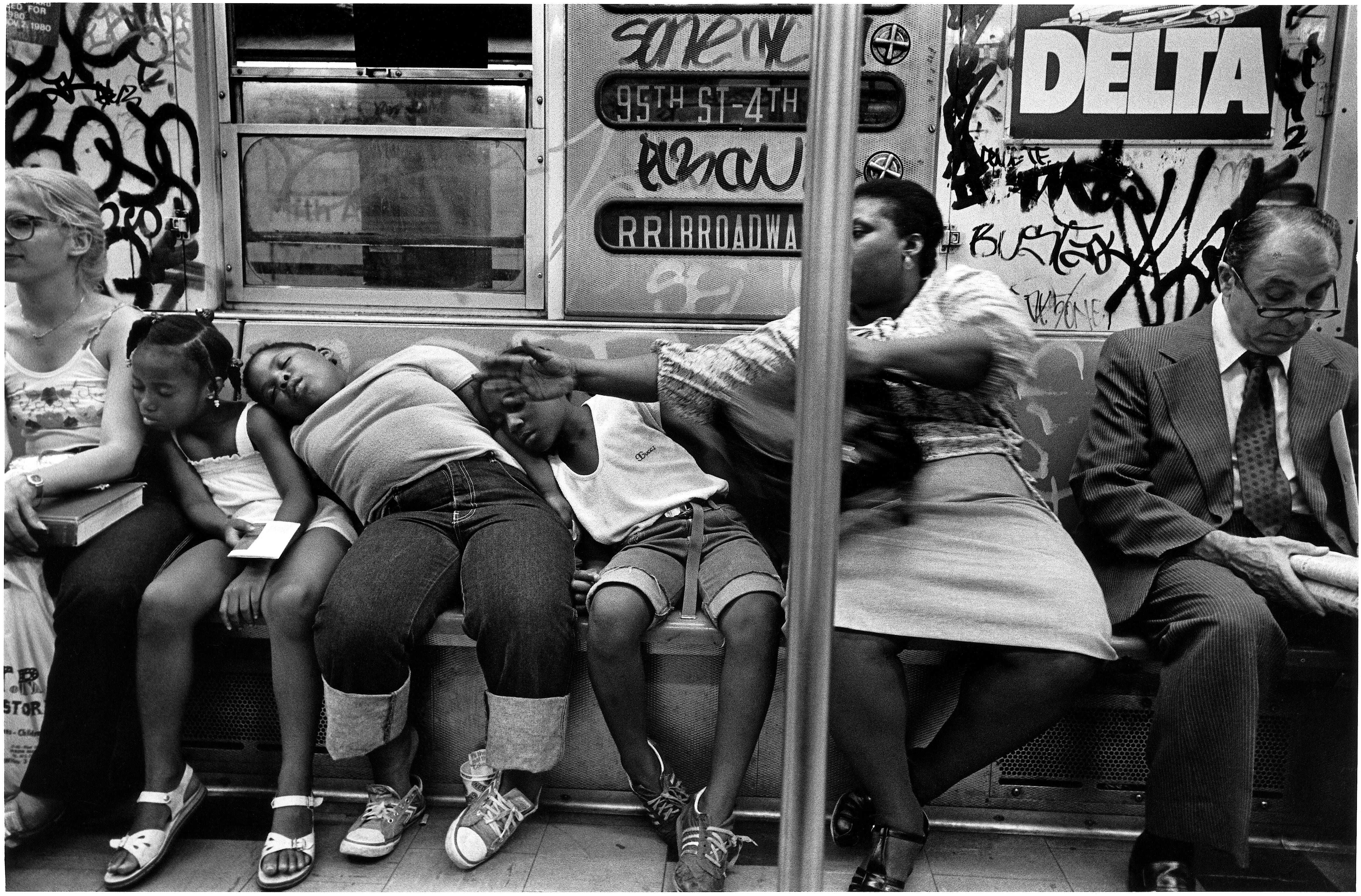 Kids asleep on woman in subway, 1981 Richard Sandler Photography