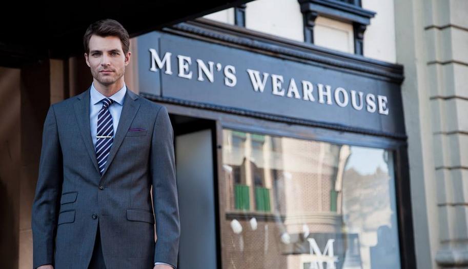 A model standing outside a Men's Wearhouse store Men's Wearhouse Facebook