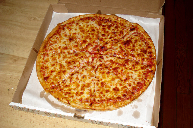 The holy pizza bible is written with pizza sauce on the dough. image - Flickr / The Pizza Review