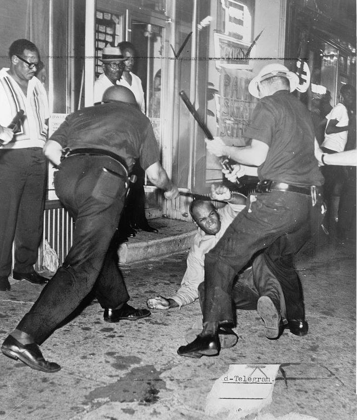 Incident at 133rd Street and Seventh Avenue during the Harlem Riots of 1964, photographed by a staff photographer of the New York World Telegraph & Sun.
