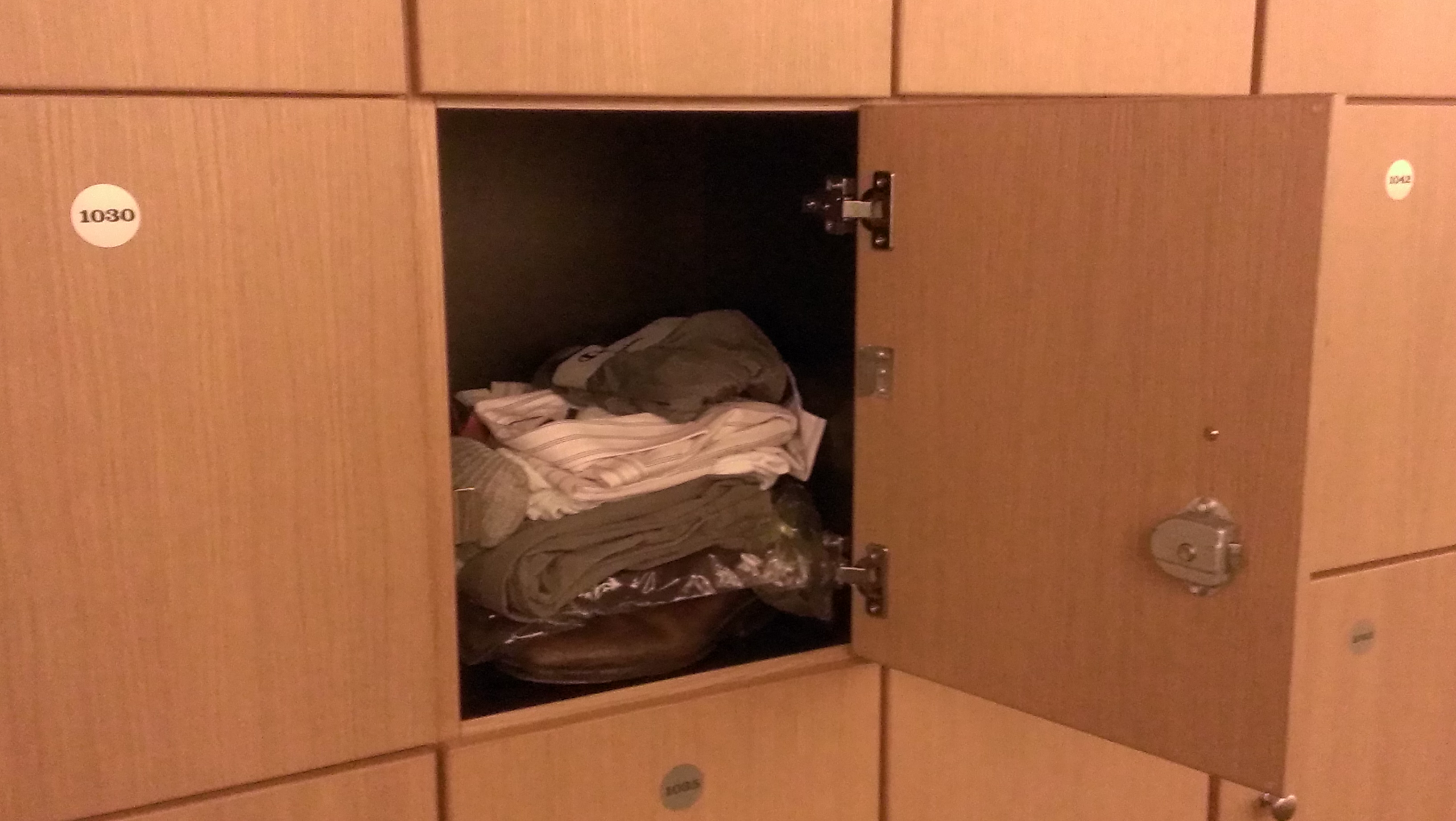 """One of nine cubbies—this one he calls the """"closet""""—Felix rents to store his personal belongings."""