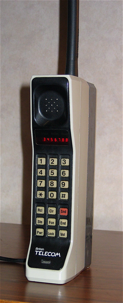 A Motorola DynaTAC 8000X from 1984. This phone has an early British Telecom badge and primitive red LED display.