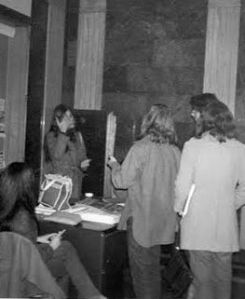 early march 1973 ppl at desk