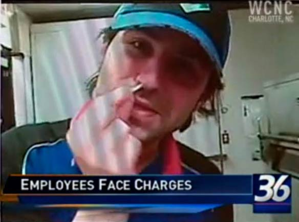Domino's worker sticks shredded mozzarella in his nose before putting it on a pizza. Via YouTube.