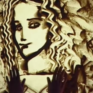 This Woman's Sand Animation Is Haunting And Completely Mesmerizing