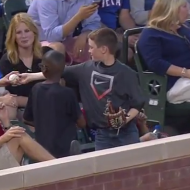 You Have To See What This Young Boy Does To Impress The Ladies Sitting Behind Him