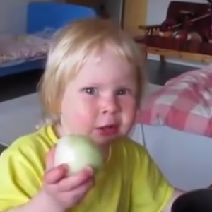 Watch This Little Toddler Bite Into A Crisp Onion And Do It Over And Over Again
