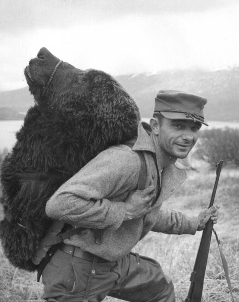 American bear hunter in Alaska, 1957, Wikimedia Commons