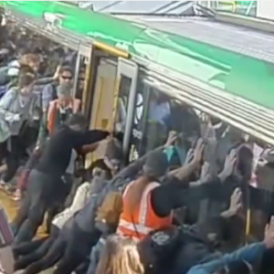 Bad Ass! Aussie Commuters Pitch In To Lift A Train Off A Man's Leg