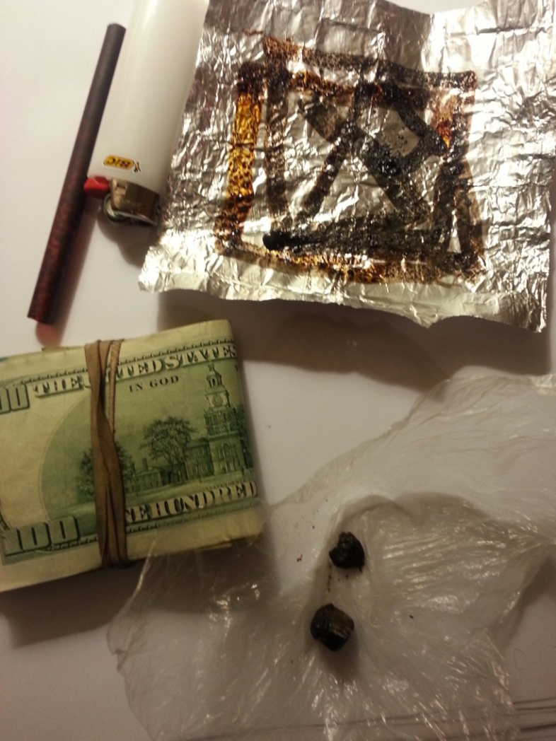 Heroin, Money, and Paraphernalia presented during interview. Photo by Jason Smith