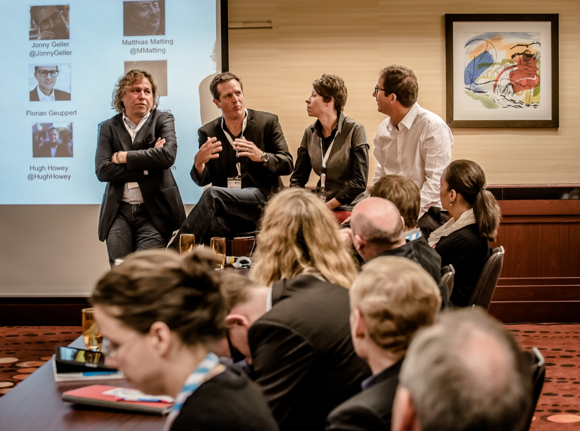 Amazon's Jon Fine, left, in a town hall panel at Frankfurt Book Fair's 2013 CONTEC Conference, with the author Hugh Howey and literary agents Kristin Nelson and Jonny Geller. | Photo: Bernd Hartung