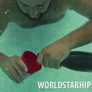 Watch DJ Khaled Try To Pour Champagne Underwater (And Other Acts Of Idiocy)