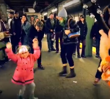 Why A Little Girl Dancing In The Subway Is Our New Santa Claus