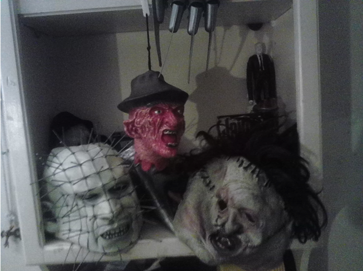 Yes, that is a handmade Slenderman action figure above Leatherface.