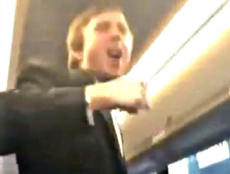 Tuxedo-clad member of Sigma Alpha Epsilon fraternity at University of Oklahoma leads a bus full of partygoers on a racist chant Saturday night.  / ((The Unheard Movement via YouTube))