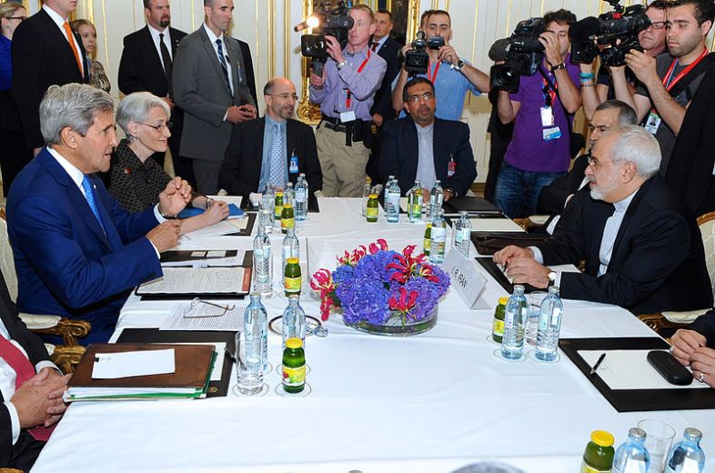 U.S. Secretary of State John Kerry prepares to sit down with Iranian Foreign Minister Mohammad Javad Zarif in Vienna, Austria, on July 14, 2014, before they begin a second bilateral meeting focused on Iran's nuclear program. [State Department photo/ Public Domain]