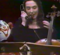 charlotte moorman on phone with cello