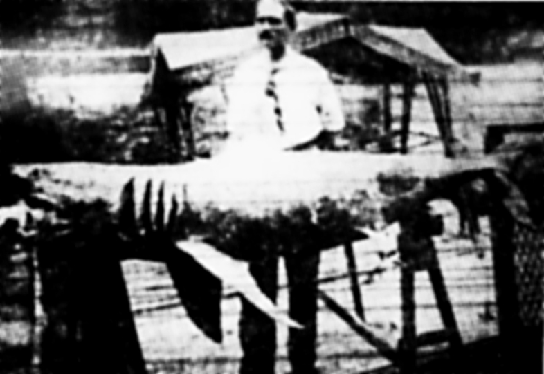 Michael Schleisser posing with a young white shark that may have been responsible for some of the infamous July 1916 attacks in New Jersey. (Wikimedia Commons)