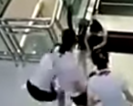 Disturbing Security Footage Shows Chinese Mother Killed By Escalator After Saving Son