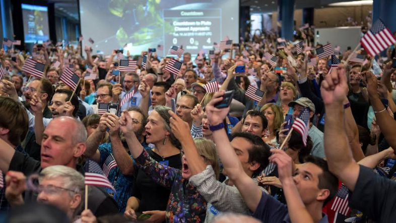 NASA New Horizons team members and guests celebrate the spacecraft's closest approach to Pluto, 14 July, at Johns Hopkins University Applied Physics Laboratory. Photo: NASA / Bill Ingalls