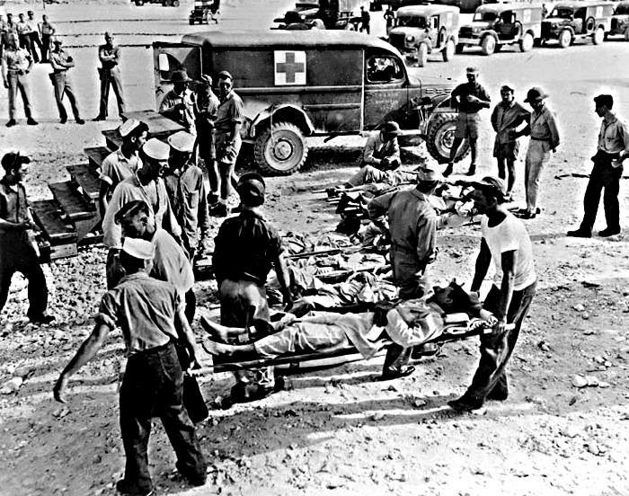 Rescue workers with survivors of the USS Indianapolis disaster. (Wikimedia Commons)