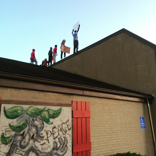 Ferguson protesters on a building