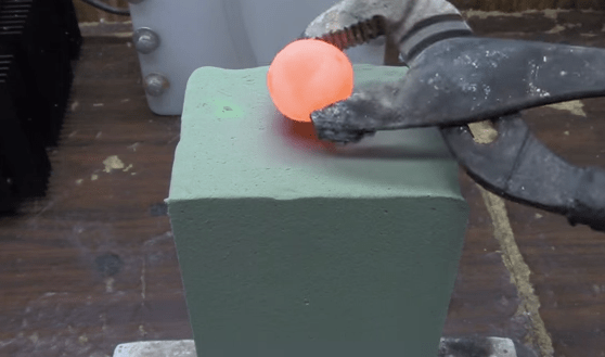 Watch This Super Captivating Video Of A Red Hot Nickel Ball DESTROYING Block Of FloralFoam