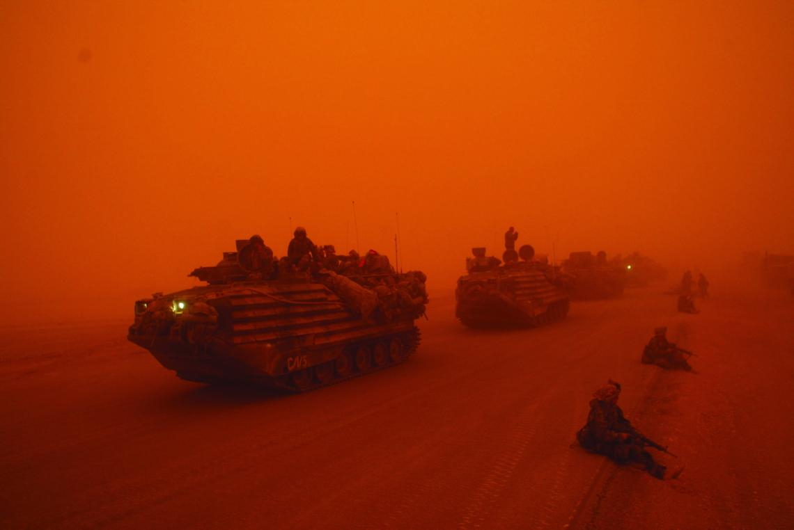 FILE -- A severe sandstorm blanketed a convoy from the Headquarters Battalion of the 1st Marine Division north of the Euphrates River in Iraq, on March 25, 2003. President Barack Obama announced Oct. 21, 2011, that the United States had fulfilled its commitment in Iraq and would bring all U.S. troops home by the end of the year. (Ozier Muhammad/The New York Times) EDS NOTE: PHOTO HAS ORANGE OVERCAST BECAUSE OF SAND STORM - DO NOT COLOR-CORRECT
