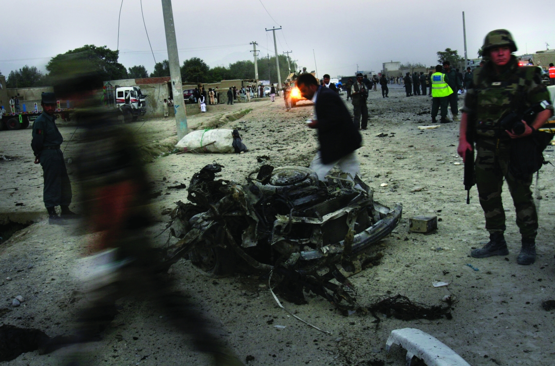 French soldiers arrive to the scene where a car bomber killed three Afghan police and wounded five people in Kabul, Afghanistan, Monday, Sept. 18, 2006. A suicide car bomber killed three Afghan police and wounded five other people in Kabul on Monday, an official said. (AP Photo/Rodrigo Abd)