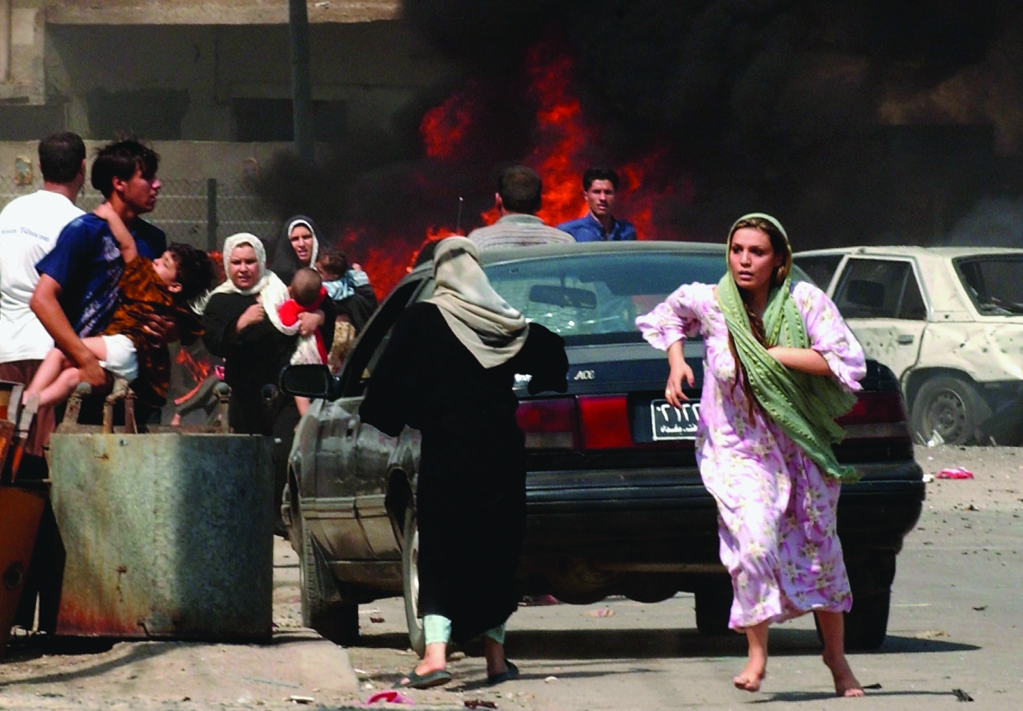 BAGHDAD, IRAQ - SEPTEMBER 30: Iraqi citizen's flee the scene after three explosions September 30, 2004 in Baghdad, Iraq. Three seperate explosions near a U.S. military convoy which was passing the opening ceremony for a sewage station killed at least 35 people and wounded more than 100 others in southern Baghdad according to Iraqi police. (Photo by Wathiq Khuzaie/Getty Images)