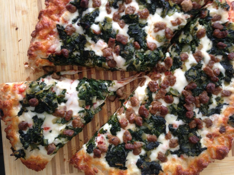 Pizza with turkey sausage, spinach and pesto