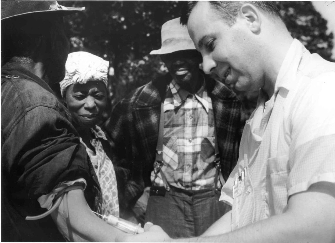 A doctor draws blood from one of the Tuskegee test subjects.
