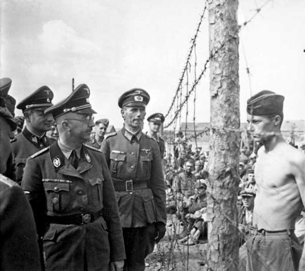 Heinrich Himmler inspects concentration camp. Horace Greasley is at right with no shirt. (Wikimedia Commons)