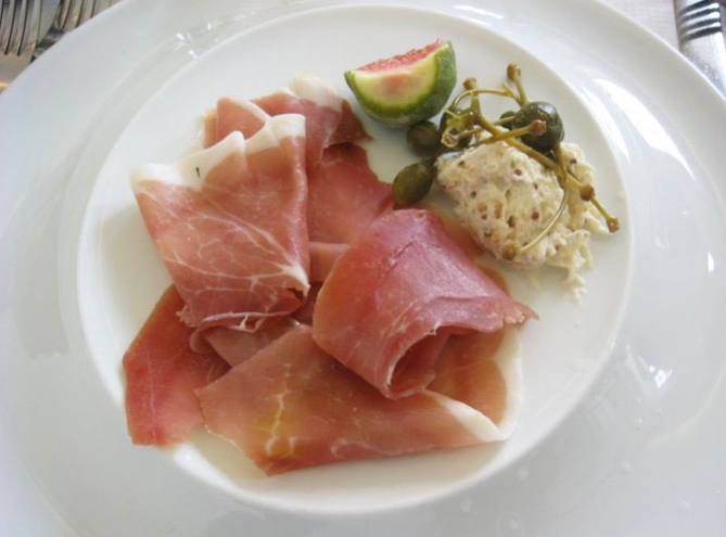Prosciutto, fig, and mustard for breakfast in Barcelona