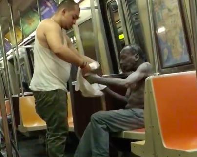 Subway Passenger LITERALLY Gives A Homeless Man The Shirt Off His Back (Despite The FreezingCold)