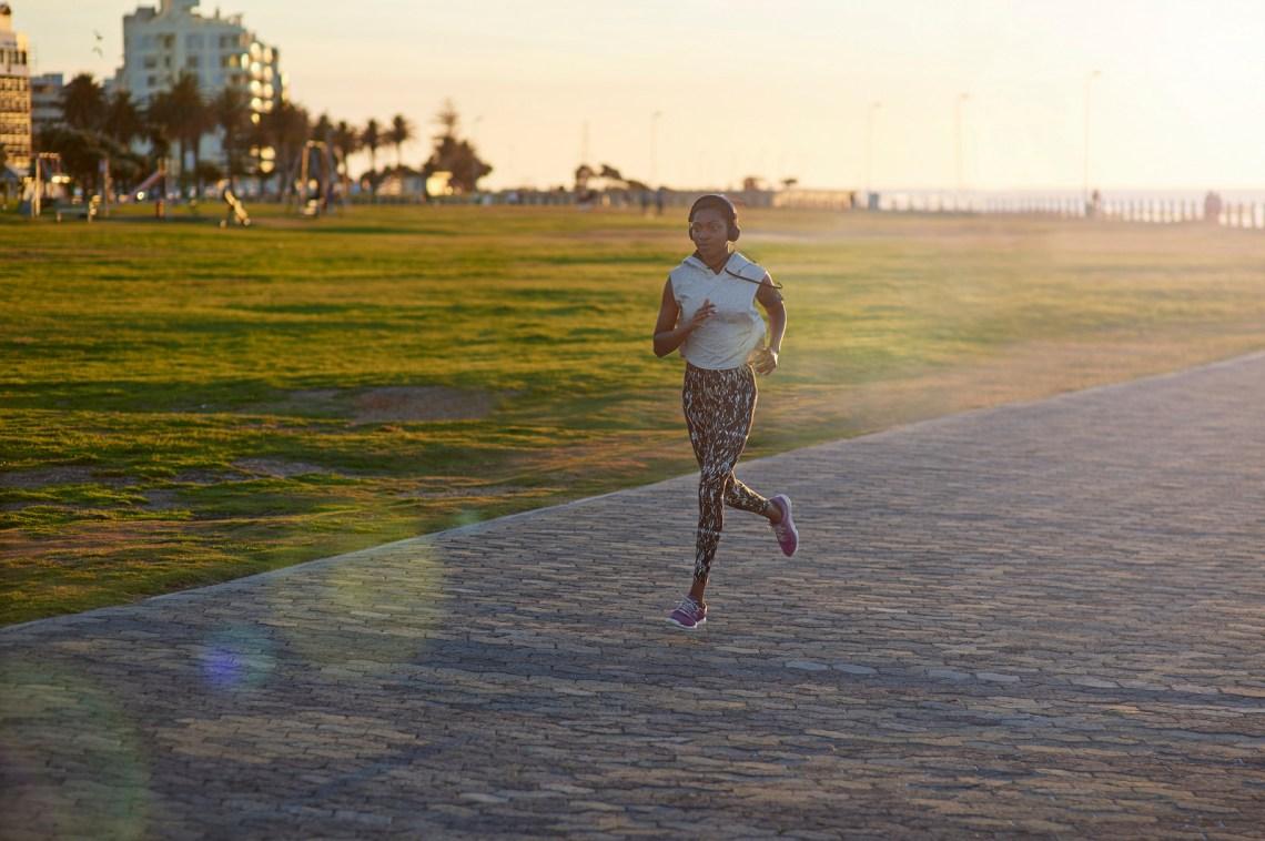 Athlete running in city park