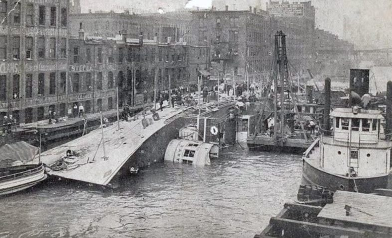 S.S. Eastland tipped over in the Chicago River, July 1915. (YouTube)