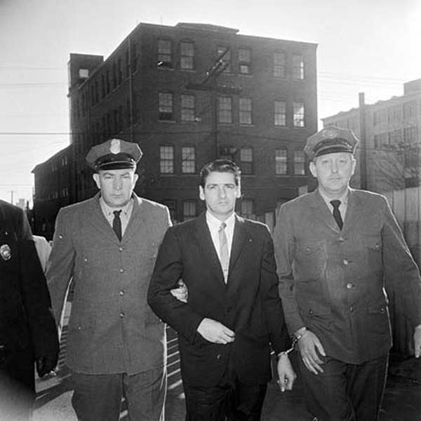 "Albert DeSalvo, AKA ""The Boston Strangler,"" being escorted by police. (Wikimedia Commons)"