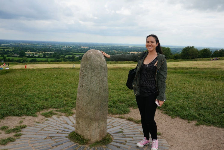 Timeless photo of me touching the phallic symbol on the Hill of Tara. All because I asked a kind stranger. Thank you kind stranger.