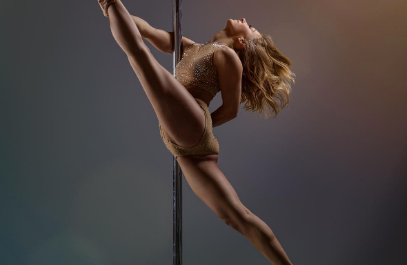 Watch The World's Best Pole Dancer Do Some Insane Things With HerBody