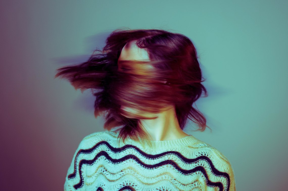 girl with hair spinning, get out of my head